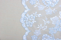 Fabric background. Blue and white lace on the fabric Royalty Free Stock Photo