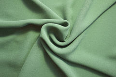 Fabric background. Green fabric texture and form Stock Photography