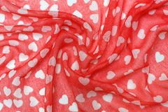 Fabric background with hearts Royalty Free Stock Photo