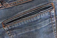 Fabric background. Part of jeans pants stock photography