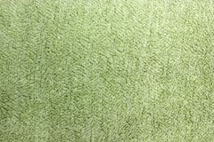 Fabric background. Top View of Cloth Textile Surface. Green thread.  stock photos