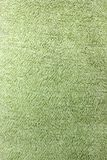 Fabric background. Top View of Cloth Textile Surface. Green thread.  stock photo