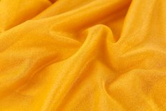 Fabric background. Yellow wrinkled fabric as a background Royalty Free Stock Images