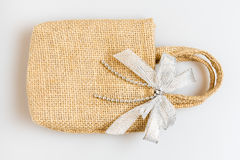 Fabric bag with bow front isolated on white background. Stock Photography