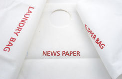 Fabric bag in hotel names news paper, laundry and slipper Stock Image