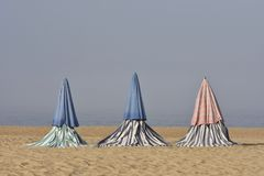 Textile beach tents in morning mist royalty free stock photography