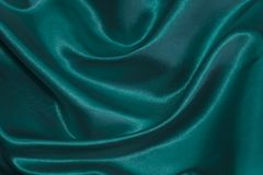 Fabric beautiful folds. Background of textiles. Blou color Stock Image