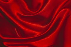 Fabric beautiful folds. Background of textiles. Red color Stock Images