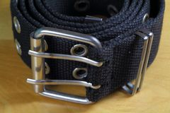 Fabric belt wind up. Close-up of a black fabric belt wind up Stock Image
