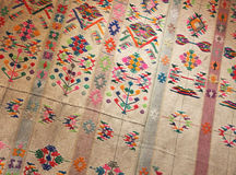 Fabric from bhutan. Foreshortened view of the texture and the colours of a dress for women from bhutan, landscape cut Royalty Free Stock Photography