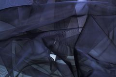 Fabric. Black mono-color silk fabric. Beautiful artistic background Stock Images