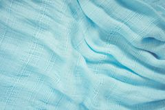 The fabric of the blue scarf. The show is a wave of light and shadow. Royalty Free Stock Image