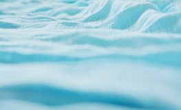 The fabric of the blue scarf. The show is a wave of light and shadow. For to be the background Stock Photo