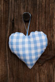 Fabric blue and white checked heart in bavarian style hanging on Royalty Free Stock Image