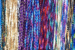 Fabric border scarf background. Background fabric strings creating scarfs, multiple colored scarves hanging in rows.. Blue, rainbow pink, yellow, purple, red stock photo