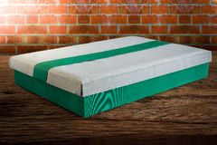 Fabric Box on wooden tabletop against grunge wall Royalty Free Stock Photography