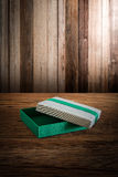 Fabric Box on wooden tabletop against grunge wall Royalty Free Stock Images