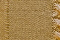 Fabric of brown color with fringe and strip Royalty Free Stock Image