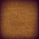 Fabric brown fabric grainy framed texture with space for text Stock Photos