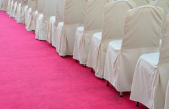 Fabric chairs on red carpet Stock Photos