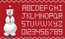 Fabric Christmas and new year script with snowman in santa hat c. Knit new year alphabet with snowman. New year red and white background with knitted alphabet Royalty Free Stock Images
