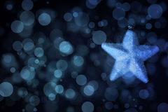 Fabric christmas star with snowflakes. Fabric christmas star on a black background with snowflakes in blue gradient colors Stock Images