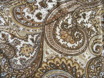 Fabric with classical east drawing. Shades brown and beige Royalty Free Stock Photo