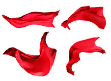 Fabric Cloth Flowing on Wind. Red Fabric Cloth Flowing on Wind, Textile Wave Flying In Motion. Isolated on White background Stock Images