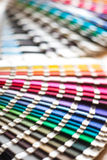 Fabric color swatches. Fabric multycolor swatches with blurry background Royalty Free Stock Photo
