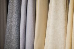 Fabric on the curtains in the store. Large suede fabric samples.  Stock Photo