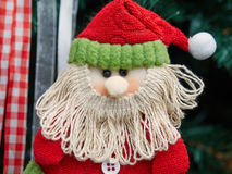 Fabric decorative santa claus hung up on Christmas tree Royalty Free Stock Photos