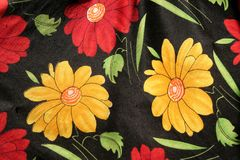 Fabric Design. Colourful floral design isolated over black on fabric Stock Photos