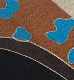 Fabric Detail. A detail of fabric with rust, blue, black and various shades of grey Stock Photography