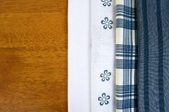 Closeup fabric texture on wooden table royalty free stock photo