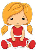 Fabric doll in red dress  on white Royalty Free Stock Images