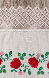 Fabric with embroidery flowers on the old wood Stock Photo