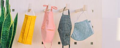 Free Fabric Face Masks Hanging On Closet Hooks. Many Colors And Patterns To Make Your Own Mask At Home For Corona Virus Royalty Free Stock Image - 215437576
