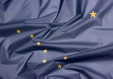 Fabric flag of Alaska. Crease of Alaska flag background, The states of America. royalty free stock photography