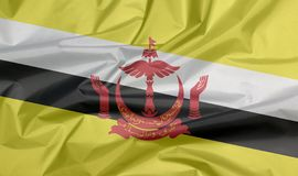 Fabric flag of Brunei Darussalam. Crease of Brunei flag background. royalty free stock image