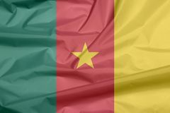 Fabric flag of Cameroon. Crease of Cameroonian flag background. Fabric flag of Cameroon. Crease of Cameroonian flag background, green, red and yellow, with a stock photography