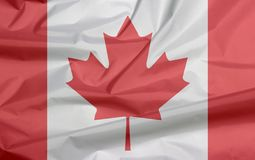 Fabric flag of Canada. Crease of Canadian flag background. stock photography