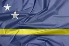 Fabric flag of Curacao. Crease of Curacao flag background. royalty free stock photography