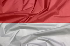 Fabric flag of Indonesia. Crease of Indonesian flag background. Fabric flag of Indonesia. Crease of Indonesian flag background, a horizontal bicolor of red and royalty free stock photography