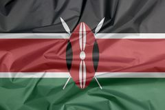 Fabric flag of Kenya. Crease of Kenyan flag background. Fabric flag of Kenya. Crease of Kenyan flag background, black white red and green with two crossed white royalty free stock images