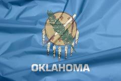 Fabric flag of Oklahoma. Crease of Oklahoma flag background. stock photography