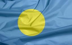 Fabric flag of Palau. Crease of Palau flag background. stock images