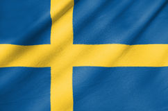Fabric Flag of Sweden. Waving in the wind Fabric Flag of Sweden Stock Images