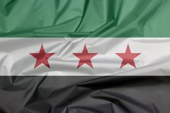 Fabric flag of Syrian Interim Government. Crease of Syrian flag background. stock illustration