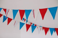 Fabric flags in white room. Fabric red and blue flags in white room Stock Photo