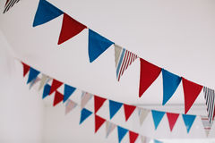 Fabric flags in white room. Fabric red and blue flags in white room Stock Image